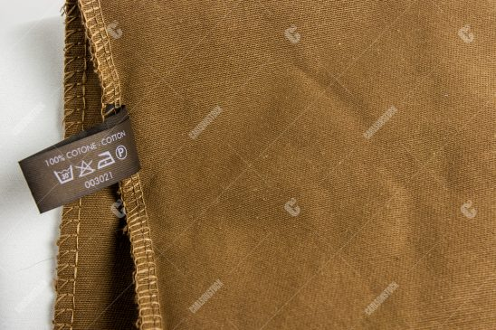 Gucci Label on Brown Fabric